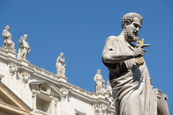 Statue of Saint Peter holding the keys of the Christian church in Saint Peter's Square Vatican City.